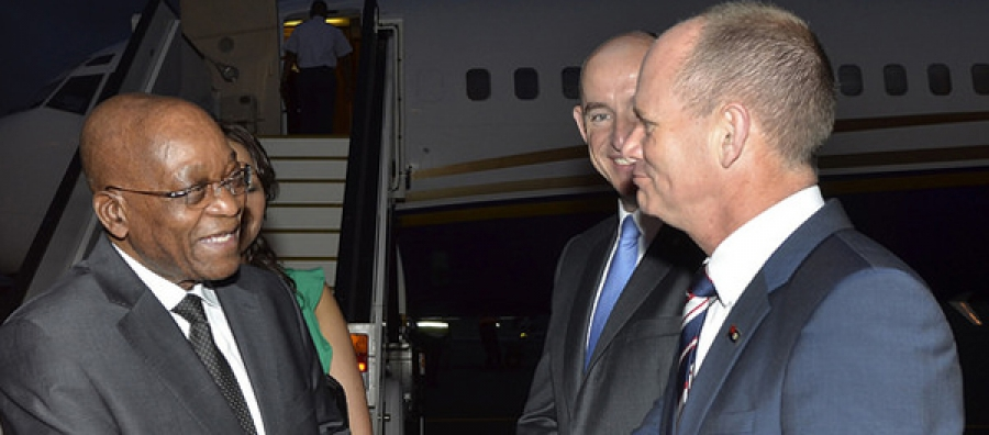 South Africa's President Jacob Zuma arriving on 12 November at Brisbane Airport for the 2014 G-20 meeting, welcomed by Australian Assistant Minister for Defence, Stuart Robert and Queensland's Premier, Campbell Newman.