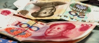 The Chinese yuan, the official denomination of some of the loans made the New Development Bank