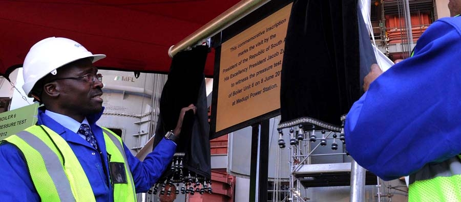 South Africa's Finance Minister Malusi Gigaba unveiling a ceremonial plaque.