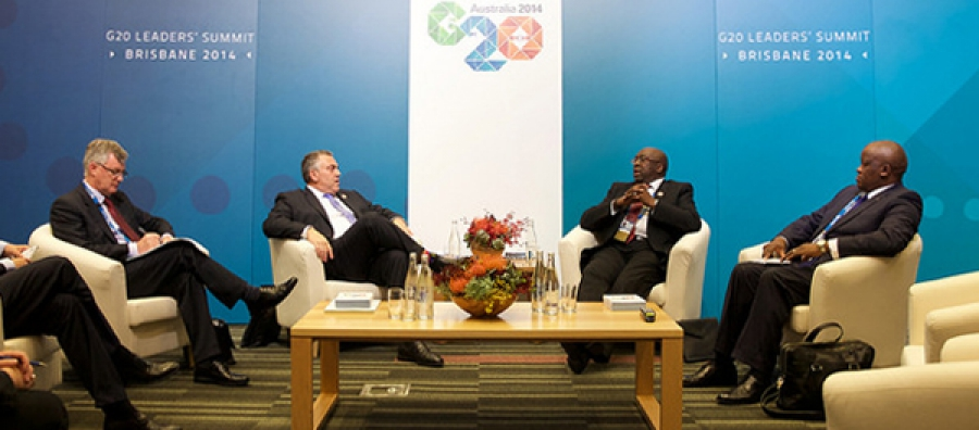Australia's Treasurer Joe Hockey greets South Africa's Minister of Finance Nhlanhla Musa Nene at the 2014 BRICS Summit, 15 November. South Africa is Africa's only permanent representative at the G20.
