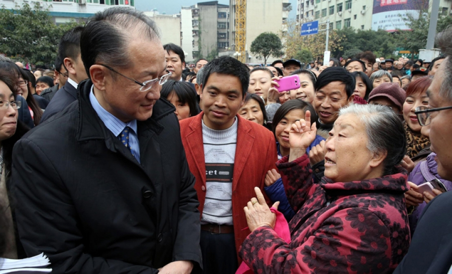 Jim Yong Kim, president of the World Bank engaging with people affected by Wenchuan earthquake. Some believe because of Kim's development background he may be the president to decrease tensions between the World Bank and civil society, whilst others remain skeptical.