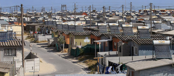 Solar panels can be seen on the roofs of residences in Khayalitsha Township in Cape Town, South Africa, 2005
